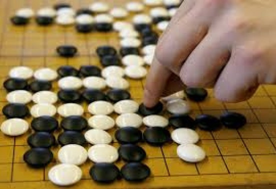 A robot with an artificial intelligence system defeated a human in Chinese Go checkers